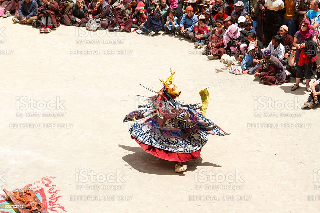 Lamayuru. Monk in deer mask performs Cham Dance with sacrifice stock photo