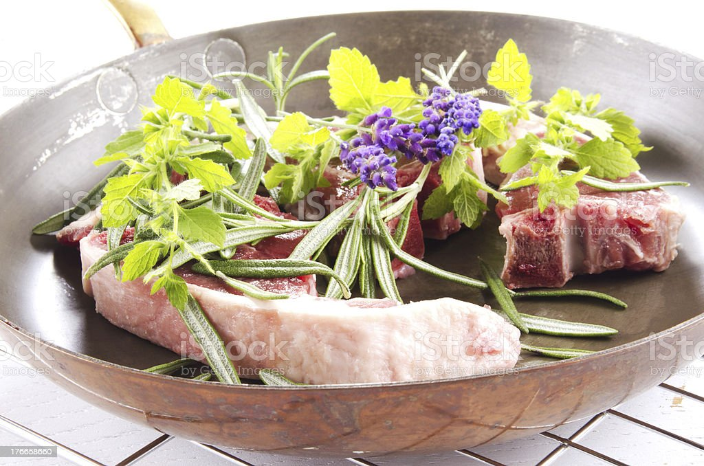 lamb chops in a brass pan royalty-free stock photo