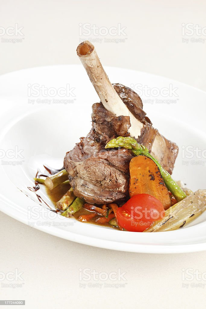 lamb chops on a bed of vegetables royalty-free stock photo