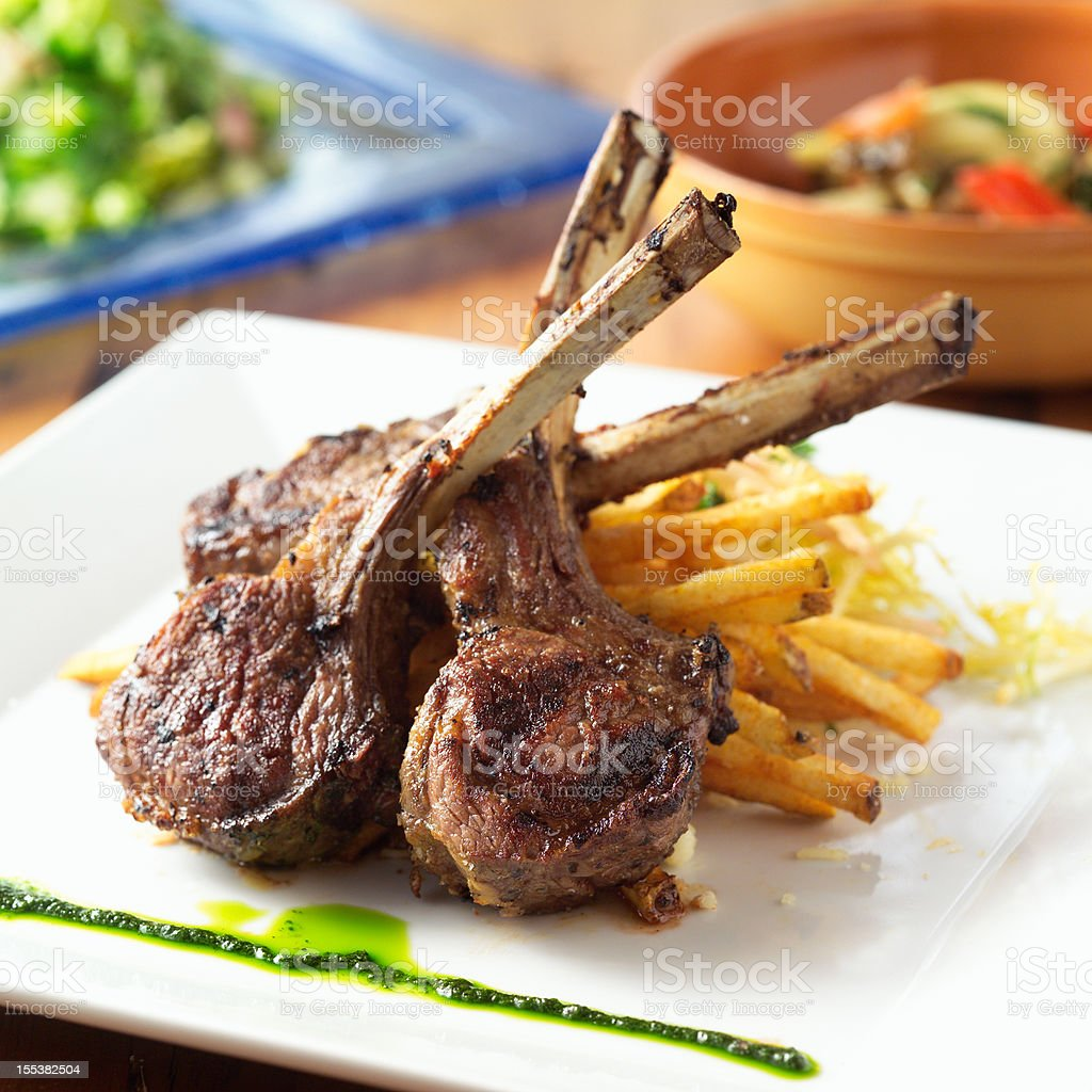 Lamb chops on a plate with a side of fries stock photo
