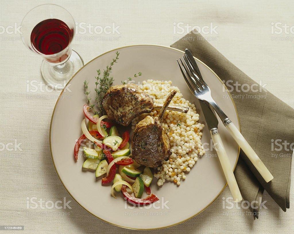 Lamb Chops with pasta and wine.Italian food. stock photo