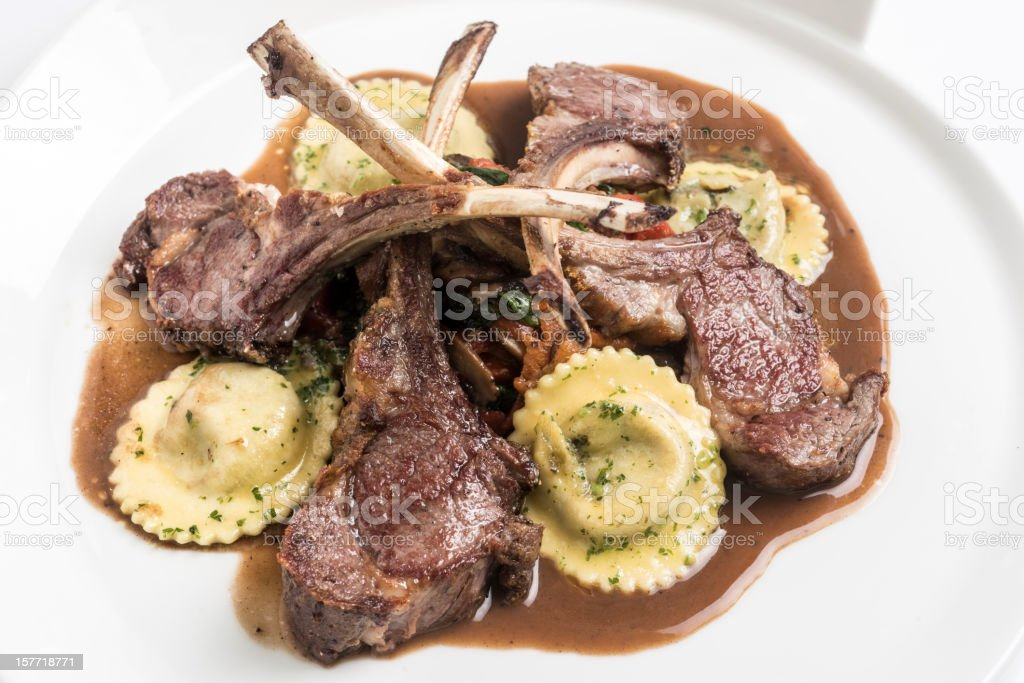 Lamb chops with ravioli stock photo