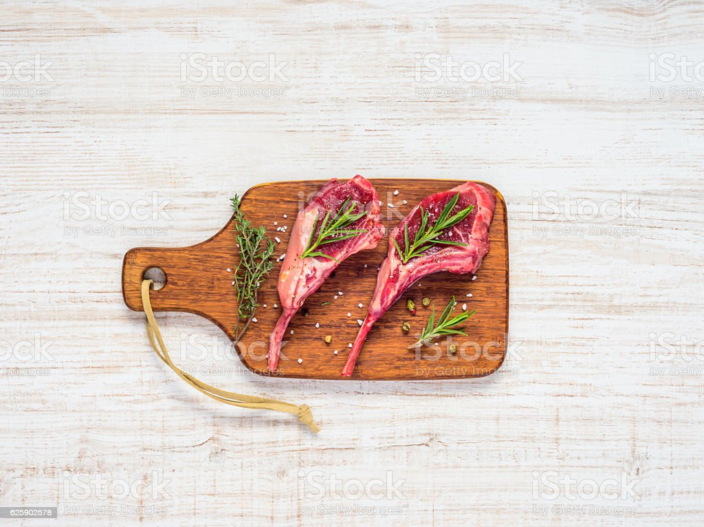 Lamb Chops with Wooden Chopping Board stock photo
