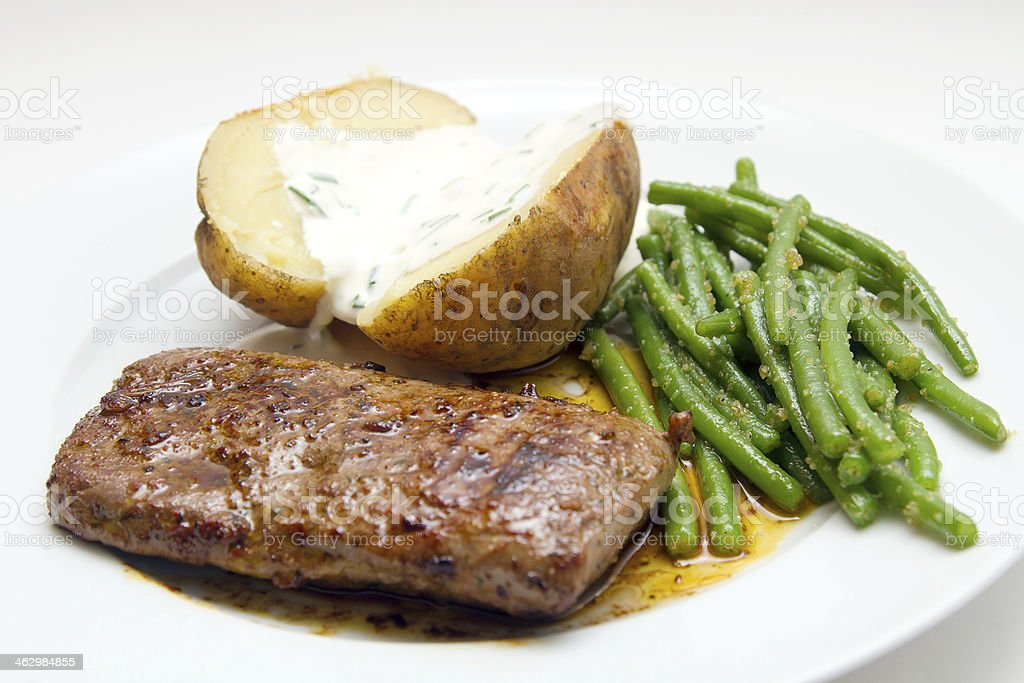 Lamb fillet with beans and potatao stock photo