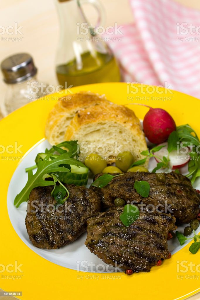 lamb fillet,grilled with arugula royalty-free stock photo