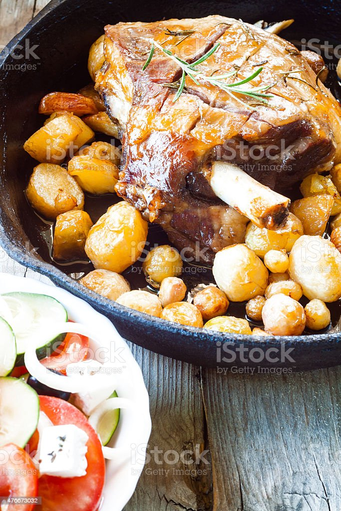 Lamb Meat with Potatoes in cast iron pan. stock photo