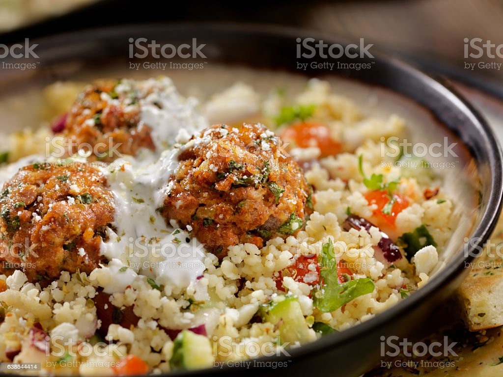 Lamb Meatballs with a Couscous Greek Salad and Tzatziki stock photo