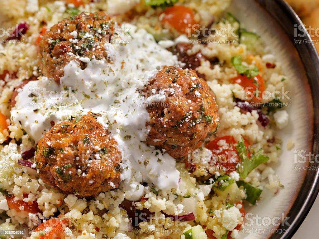 Lamb Meatballs with a Couscous Greek Salad and Tzatziki stock photo