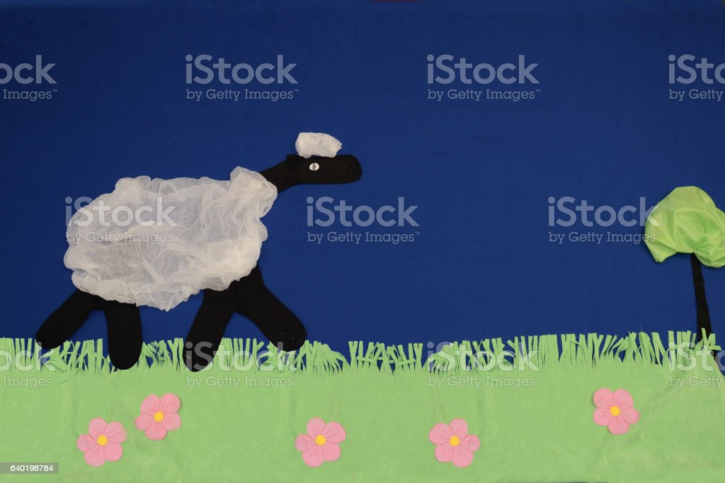 Lamb of cloth in a meadow stock photo