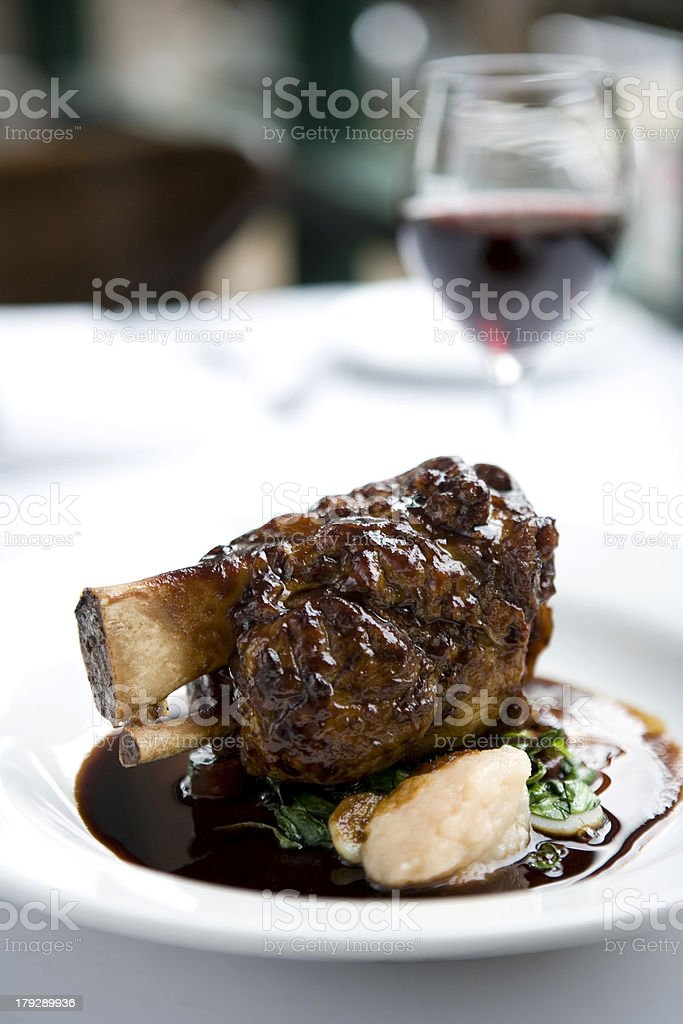 Lamb shanks with jus and red wine stock photo