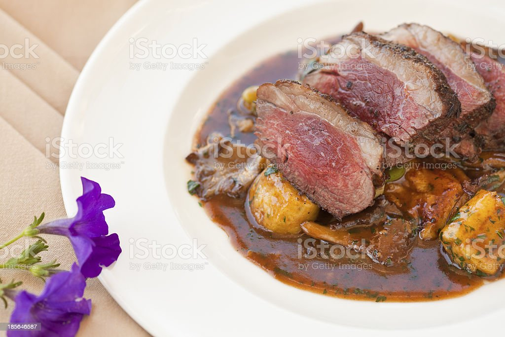 lamb sirloin with herbed gnocchi stock photo