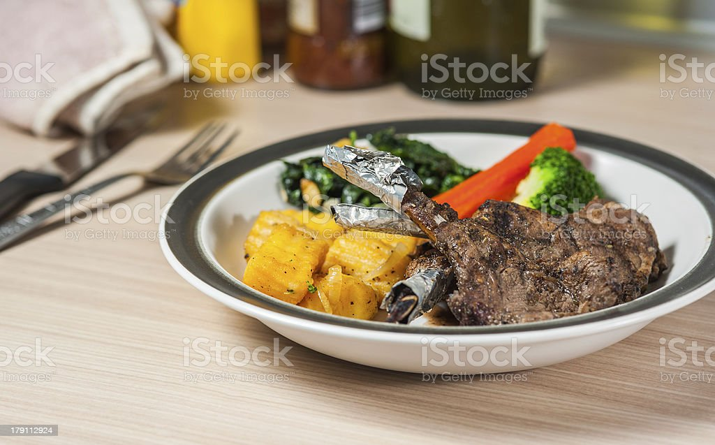 lamb steak on dish with tomatoes and vegetable royalty-free stock photo