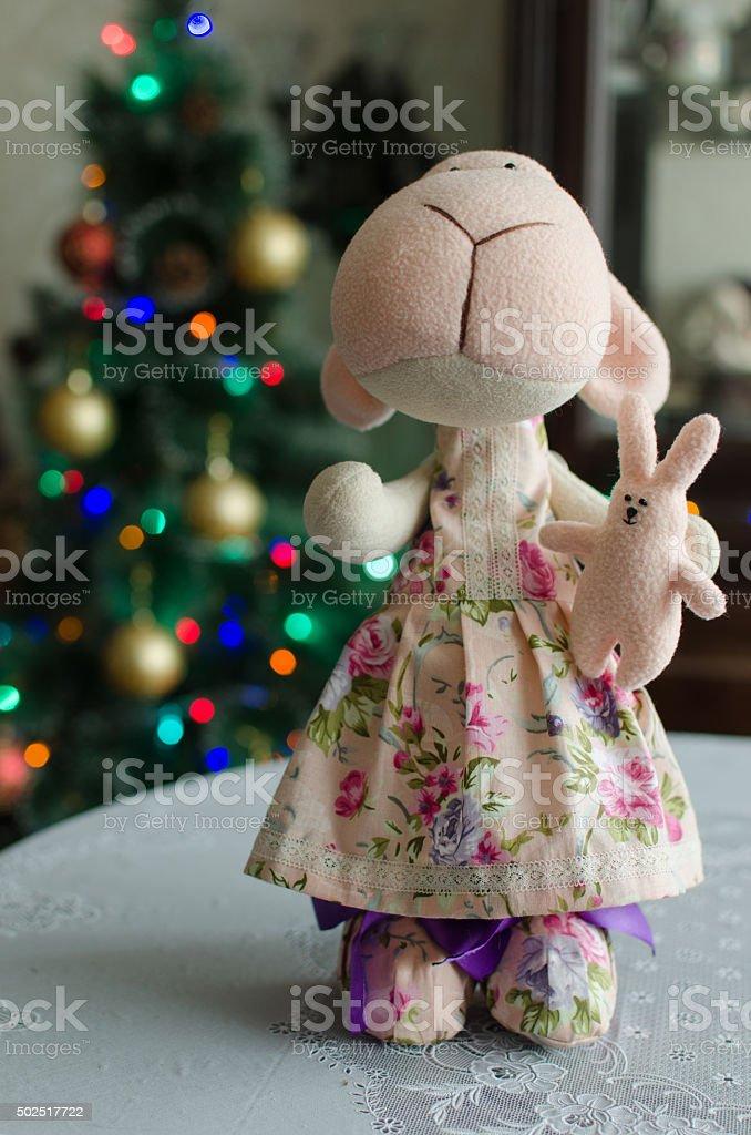Lamb with bunny Tilda - Christmas gift stock photo