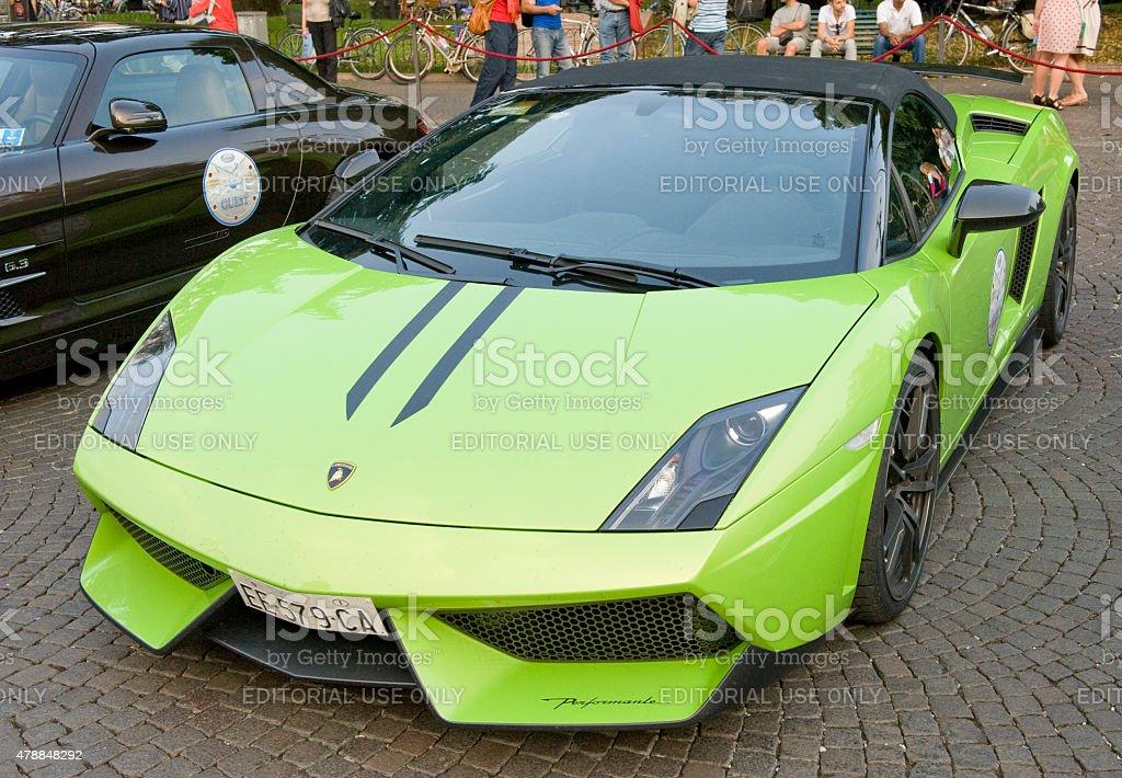 Lamborghini Gallardo draws a crowd in an Italian Piazza. stock photo