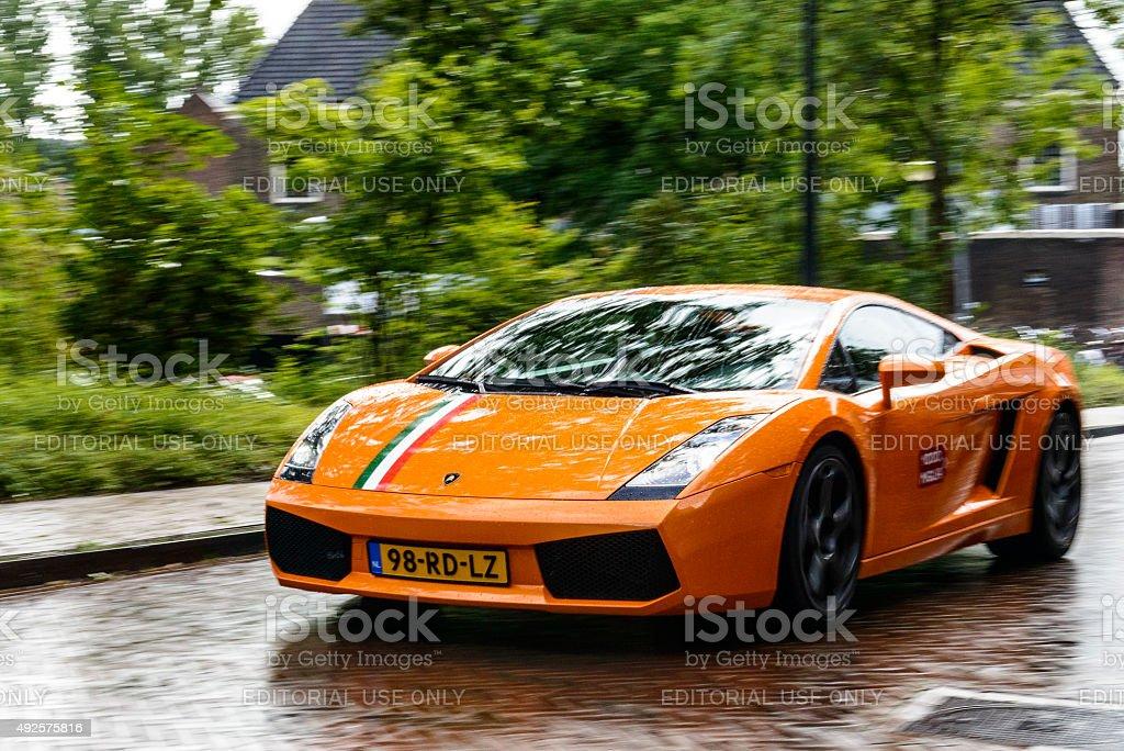 Lamborghini Gallardo driving in a city stock photo