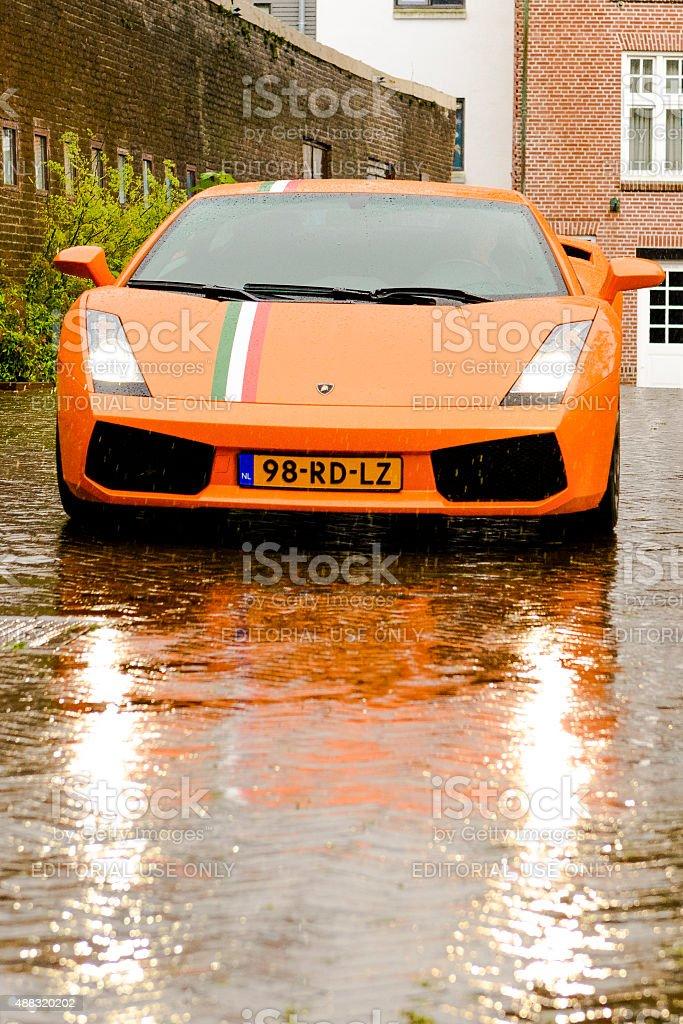 Lamborghini Gallardo driving in the rain stock photo