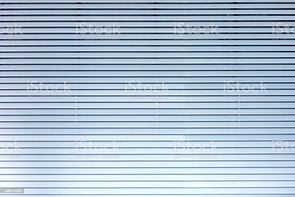 Lamellae horizontal - grey blue metal / aluminium material background stock photo