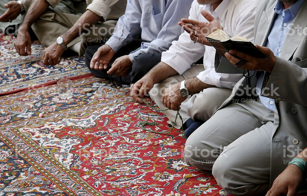 Lamenting muslims in mosque stock photo