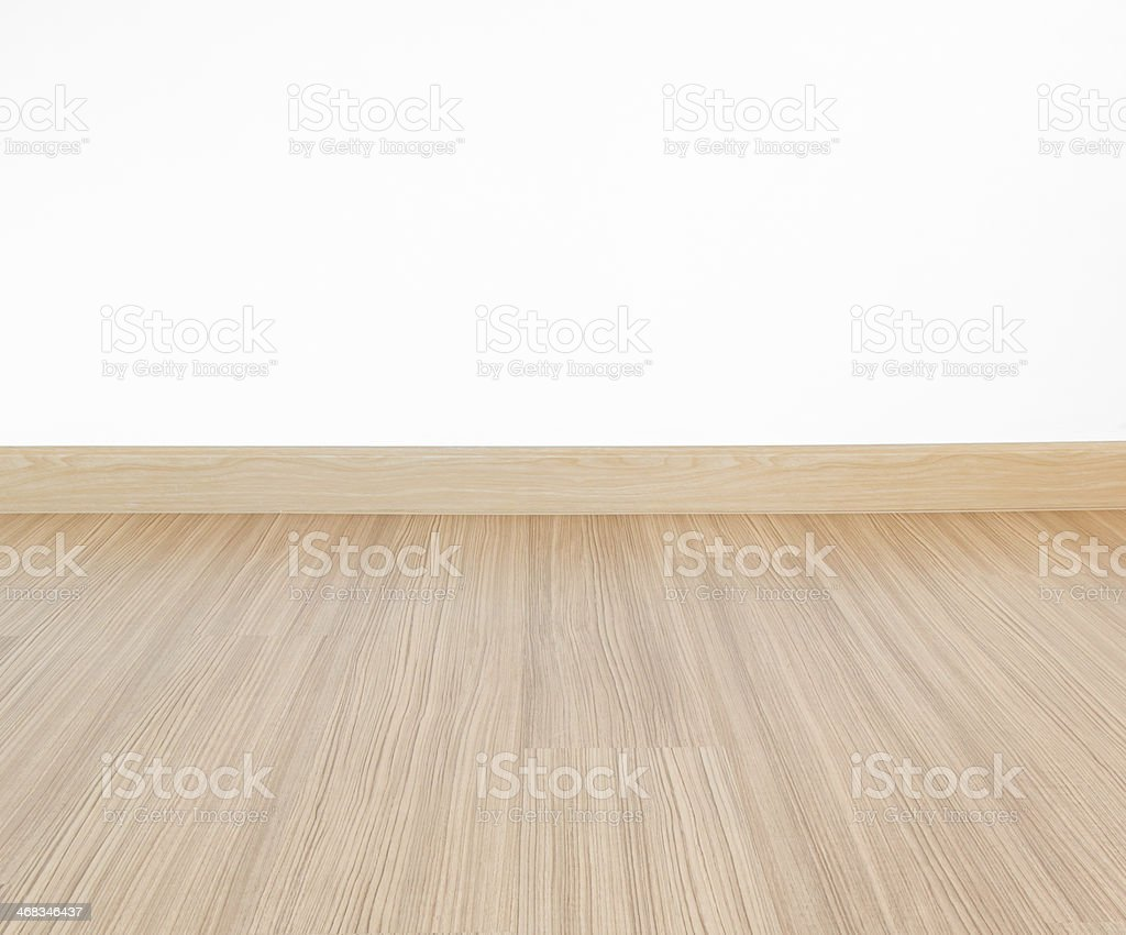 Laminate floor and white wall stock photo