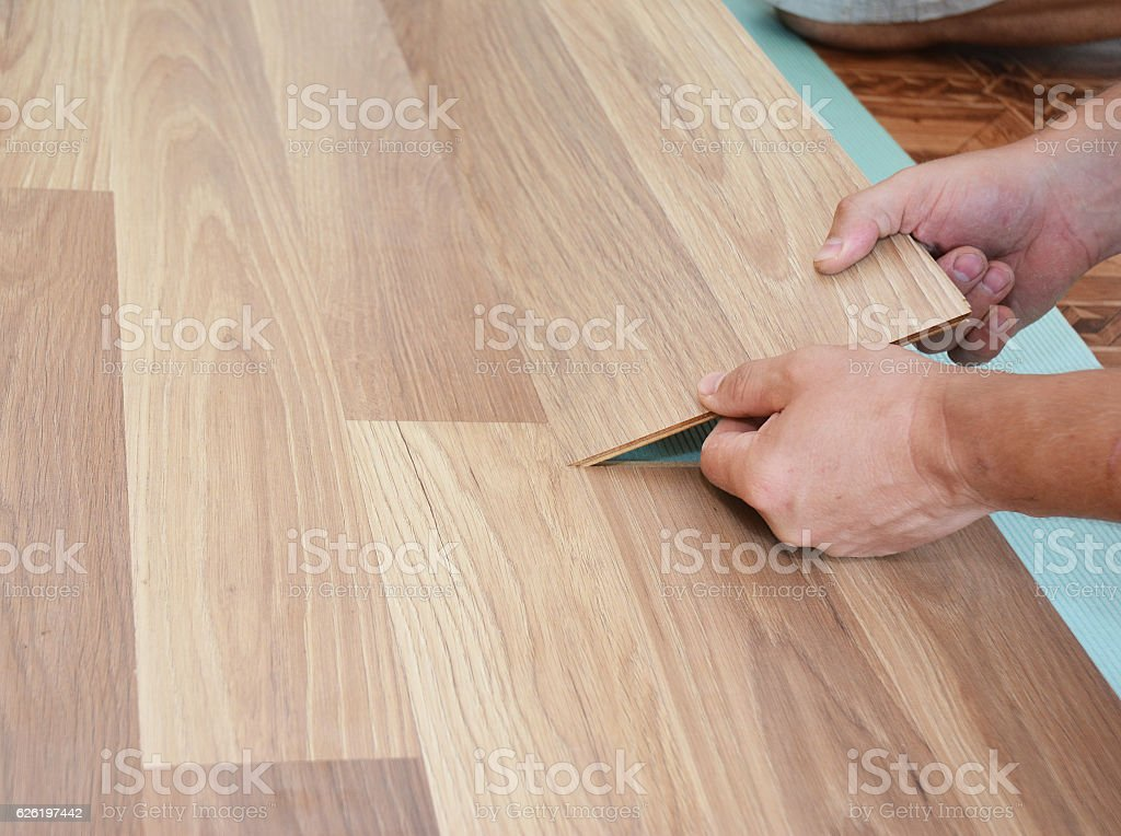 Laminate flooring installation. Installing wooden laminate flooring. stock photo