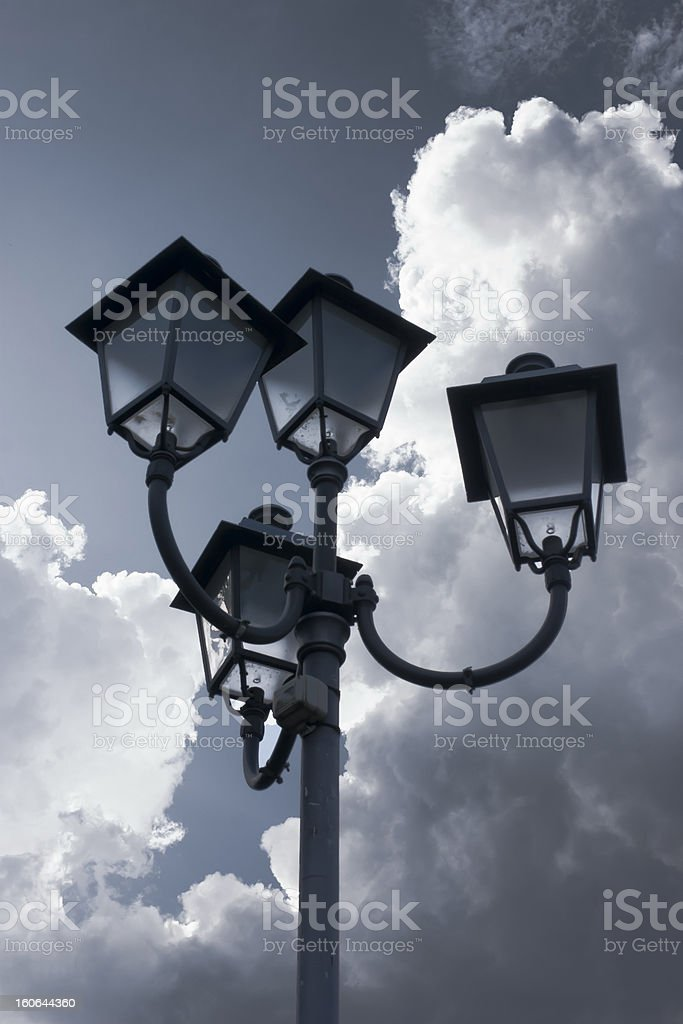 lamp against clouds royalty-free stock photo