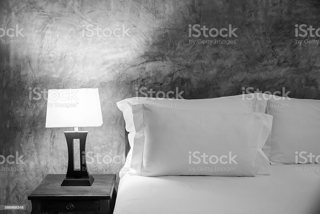 lamp and bed in the bedroom, black and white color. stock photo