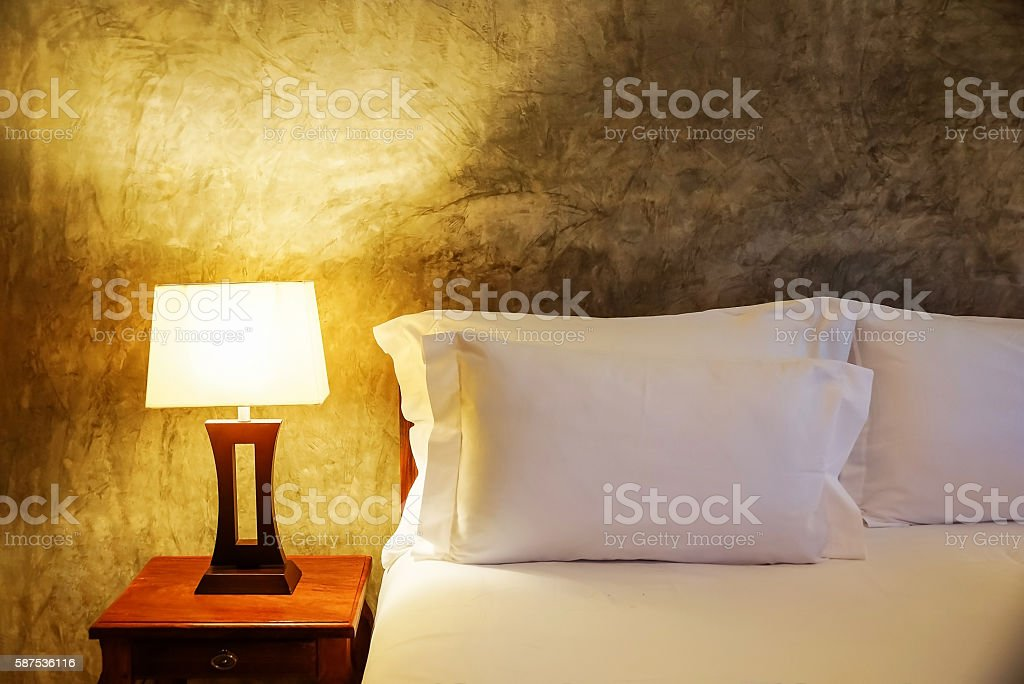 lamp and bed in the bedroom. stock photo