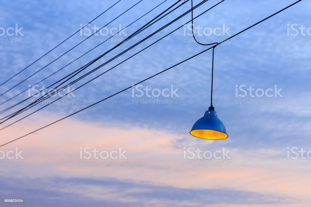 Lamp and power cables on the sky in the evening stock photo