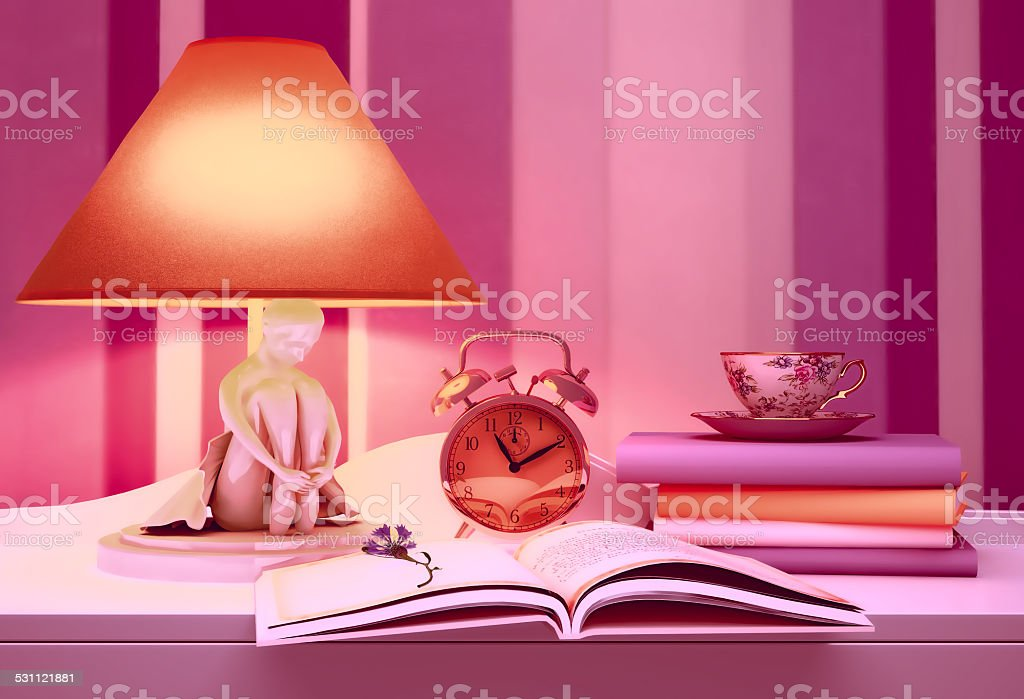 Lamp, books, hours, cup of tea. stock photo