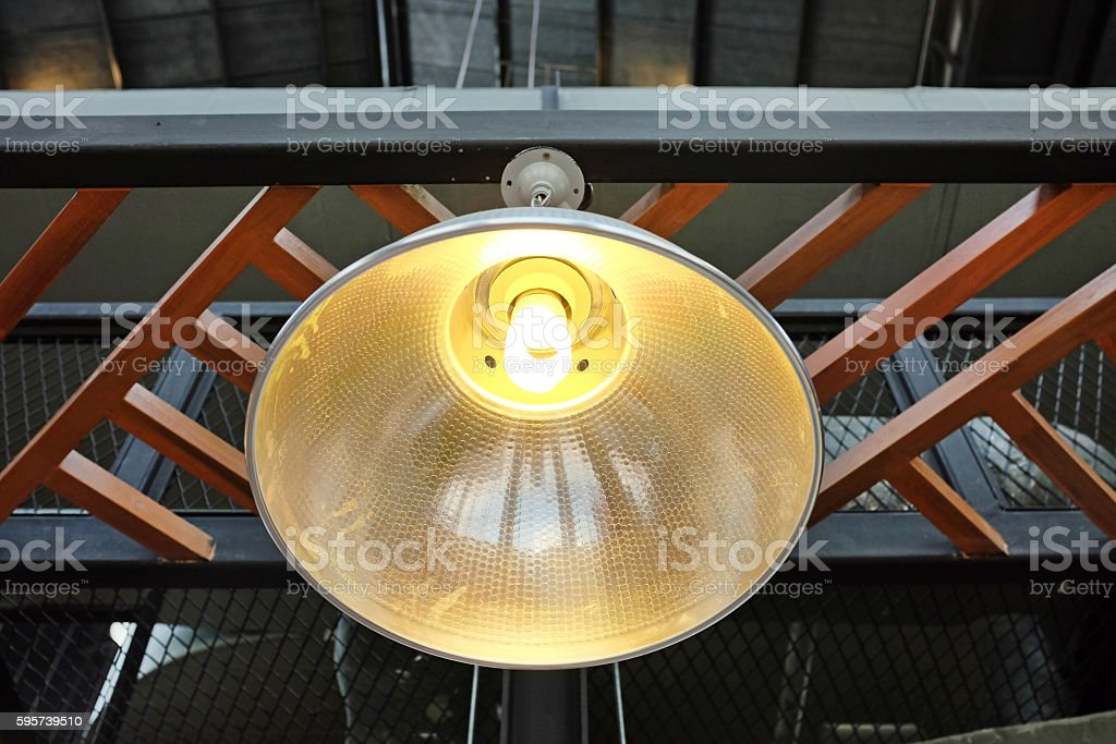 lamp hanging under the ceiling warehouse stock photo