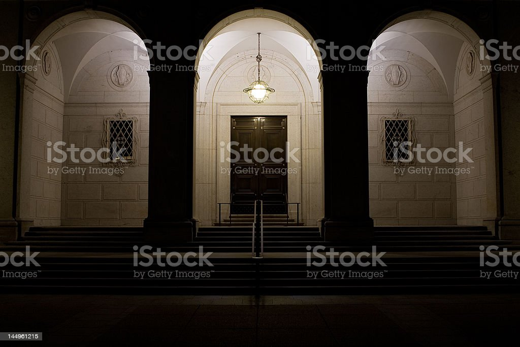 Lamp Illuminating Neoclassical Arched Doorway royalty-free stock photo