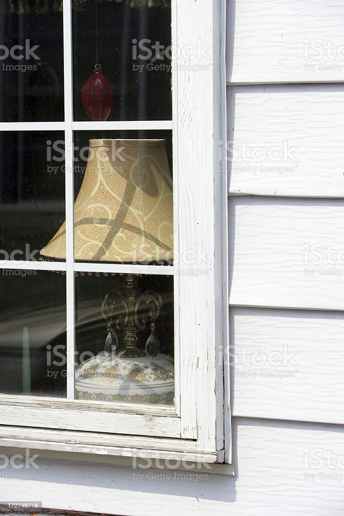Lamp in the window royalty-free stock photo