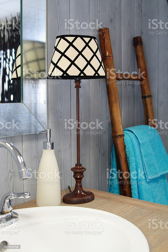 A lamp next to sink in a bathroom royalty-free stock photo