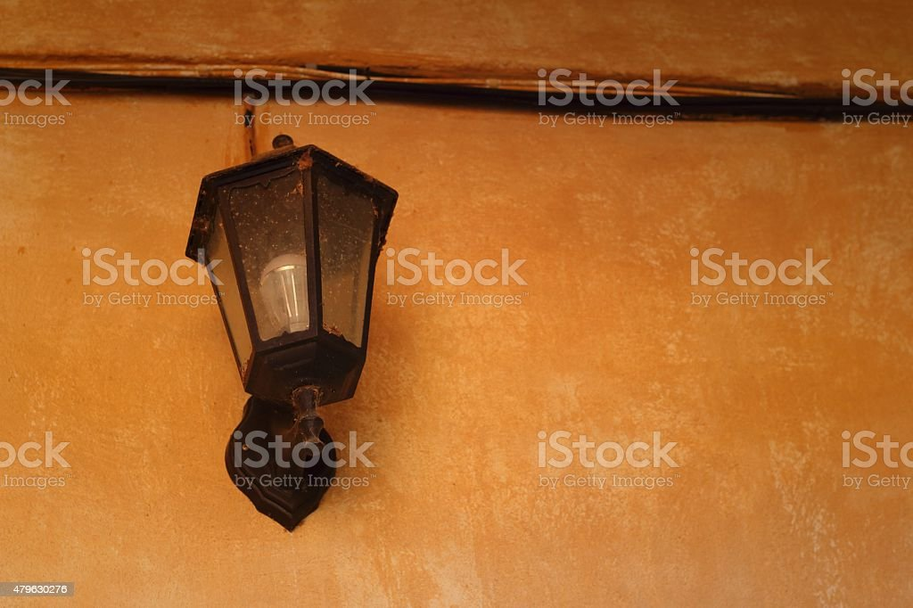 lamp on a wall on brown background. stock photo