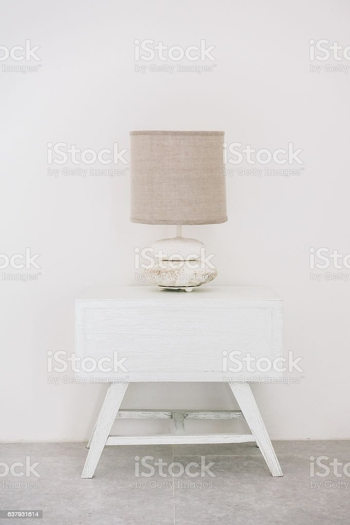 Lamp on white side table stock photo