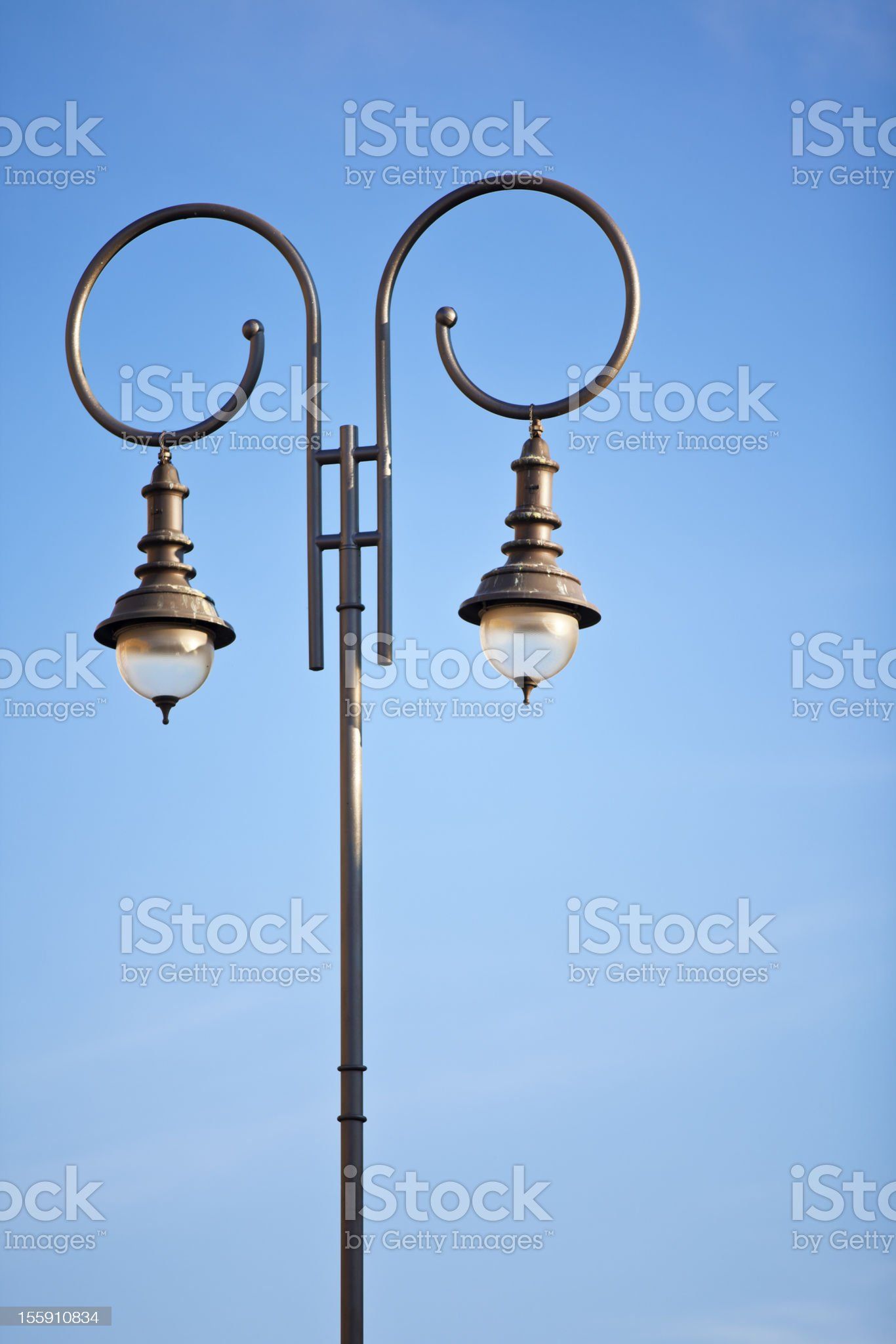 Lamp post against clear blue sky royalty-free stock photo