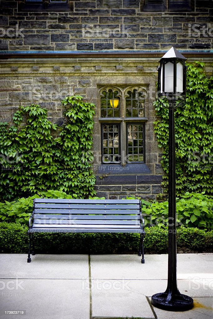 Lamp Post and Bench at a University royalty-free stock photo