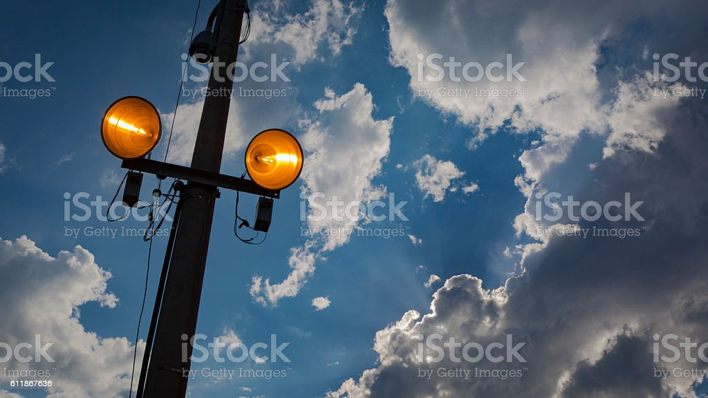 Lamp post at nightfall with clouse sky. Concept image. stock photo