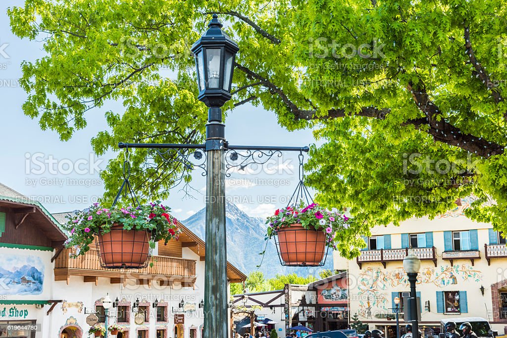 Lamp post with hanging flower pots stock photo