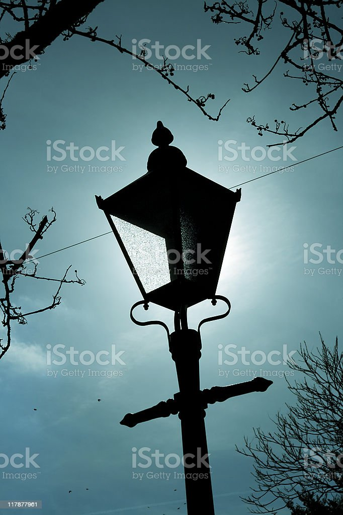 Lamp silhouette - cross processed royalty-free stock photo