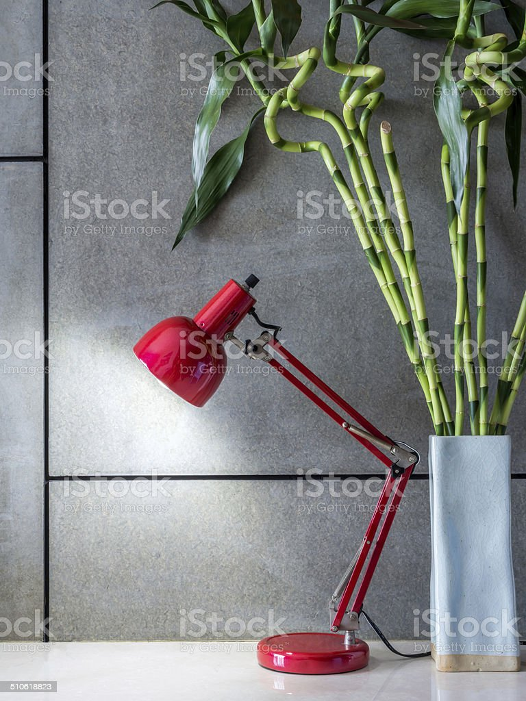 Lamp with vase of Lucky bamboo in modern room stock photo