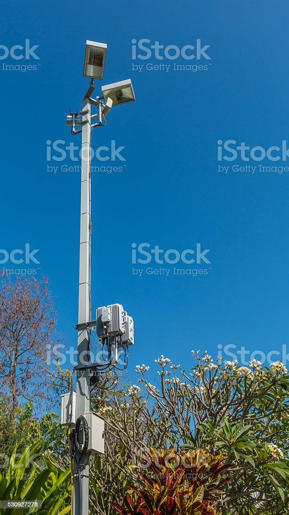 Lamp with wireless network on blue sky background. stock photo