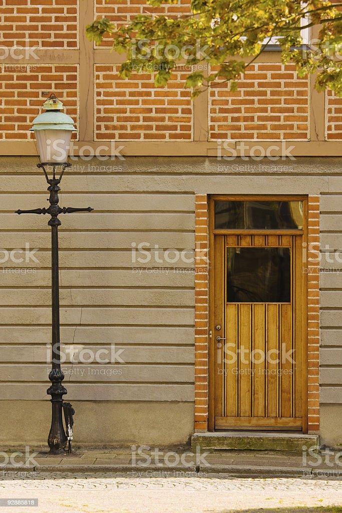 Lamppost and door stock photo