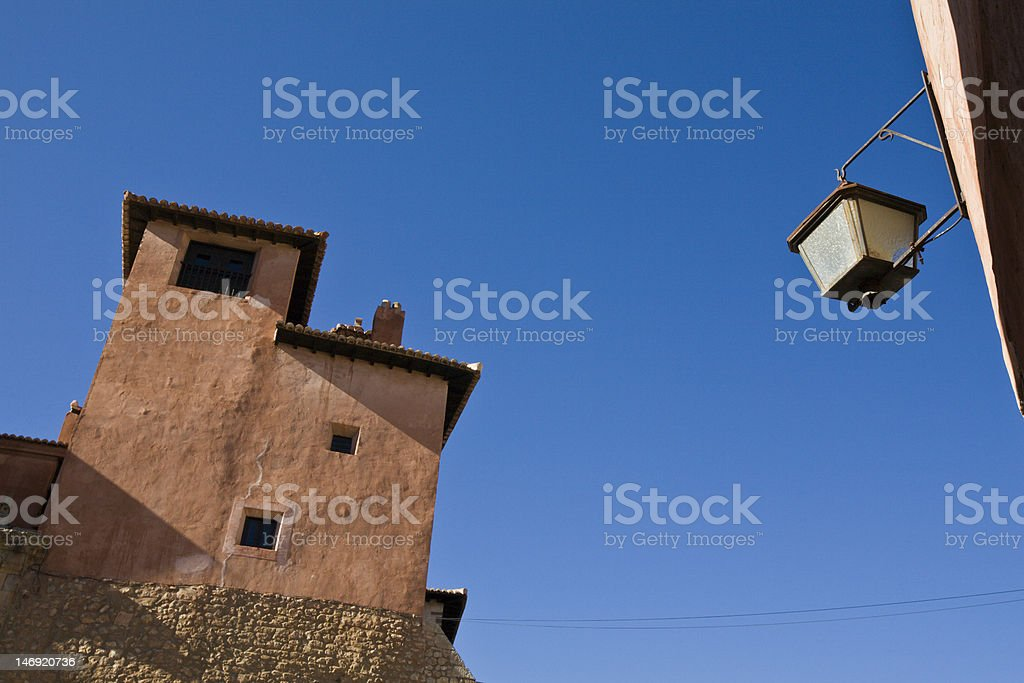 Lamppost and medieval house stock photo
