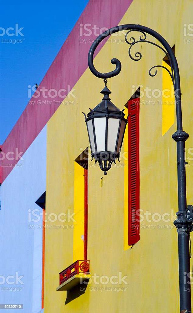 Lamppost by Yellow Wall royalty-free stock photo