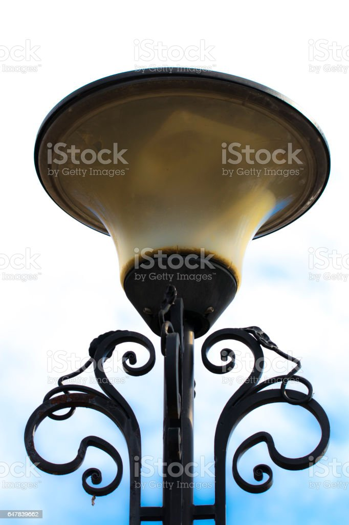 Lamppost in the sky. Old and broken stock photo