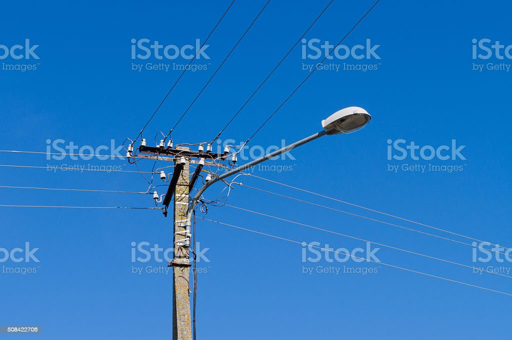 Lamppost with many electrical wires stock photo