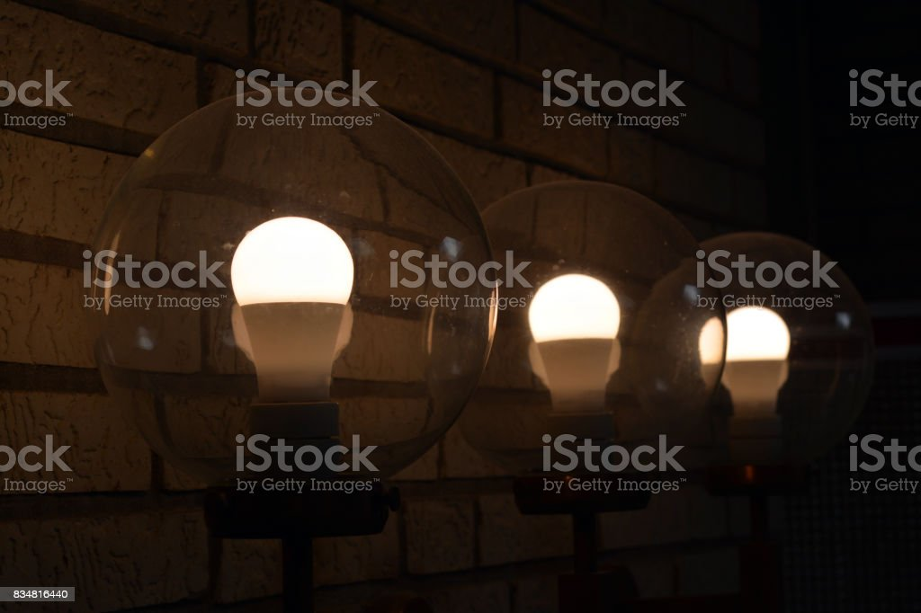 Lamps in brick wall stock photo