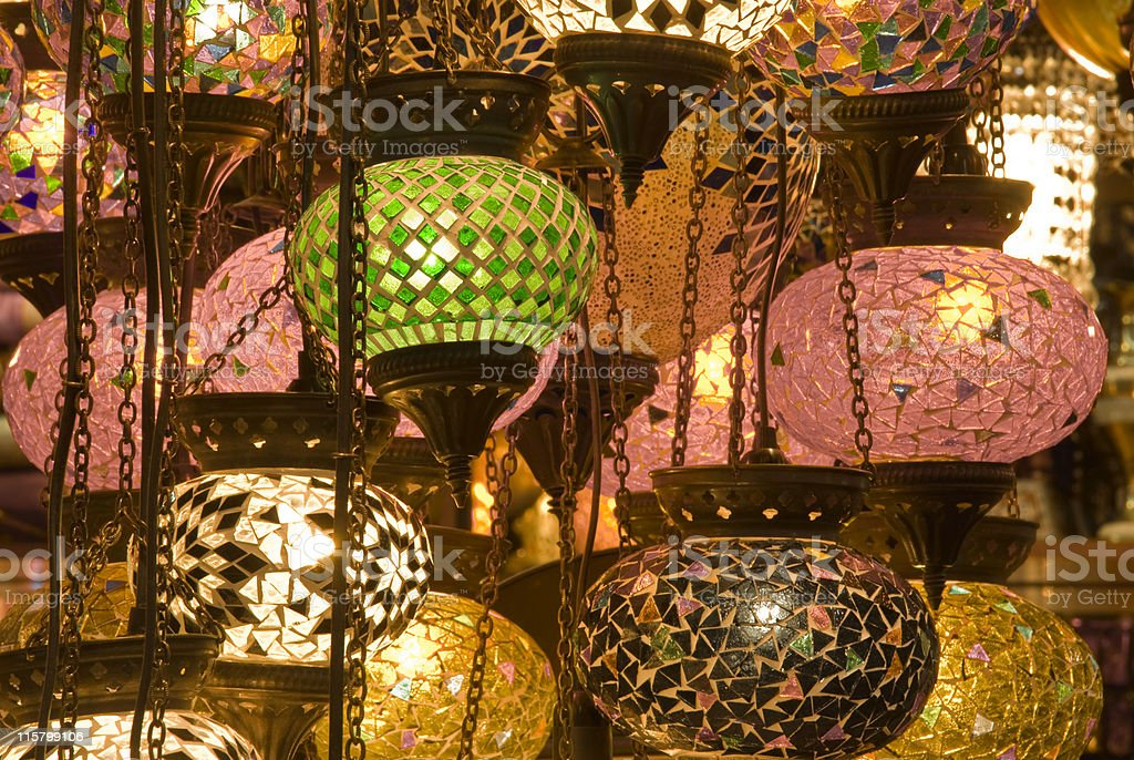 Lamps in different colors hanging on chains, made of mosaic royalty-free stock photo