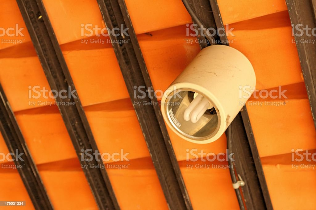 Lamps on the ceiling above the background light brown. stock photo